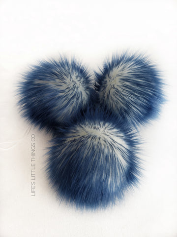 "Iced Navy Pom *White center and navy tips *Medium length fur (approximately 2"") *Full and soft feel"