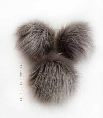 "Oyster Pom *Grey, taupe tone, medium length fur pile *Medium length fur (approximately 2"") *Full look and soft feel"