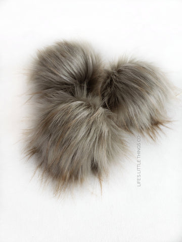 "Oxford Pom *Grey {taupe tone} in color with brown tips *Long length fur (approximately 2-3"") *Full look and soft feel"