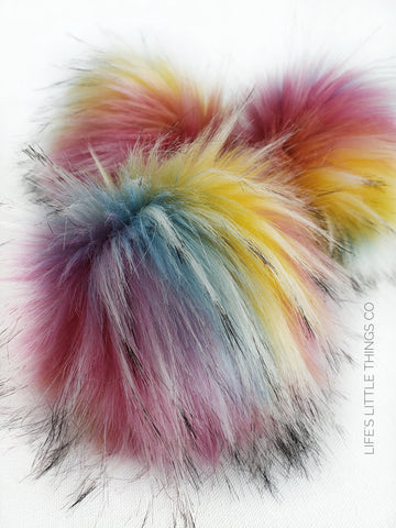 "Rainbow pom pom Pink, yellow, blue, purple, orange with tufts of white with black tips Long length fur (approximately 3"") Very full pom Luxurious and amazingly soft feel"