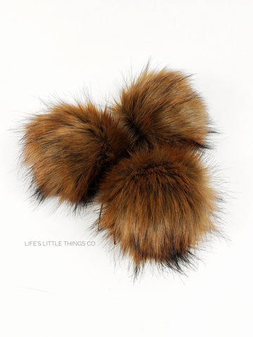 "Butterscotch Pom Warm brown center to caramel ends with black tips Medium length fur (approximately 1.5"" - 2"") Full look"