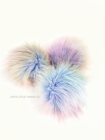 "Opal Pom Light blue in center to muted rainbow colors. NO TWO poms are alike! Medium length fur (approximately 2"" - 2.5"") Luxurious and amazingly soft feel"