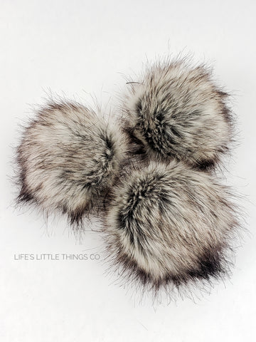 "Otter Pom Dark taupe center to a cream with brown tips.  Short length fur (approximately 1.5"" - 2"") Luxurious and amazingly soft feel"