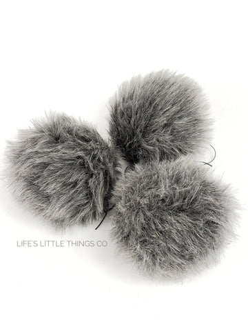 "Cottontail Pom Grey in color throughout with white hairs Short length fur (approximately .5"")"