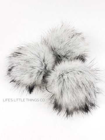 "Thunder Fox Pom Grey center to a light grey/white with black tips.  Short length fur (approximately 1.5"" - 2"") Luxurious and amazingly soft feel"