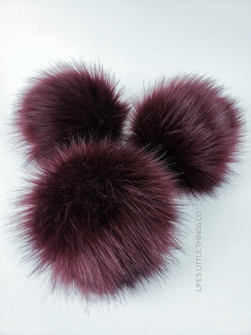 "Crimson Pom Pom Deep blood red color with black hairs throughout Long length fur (approximately 2.5"") Very full pom Luxurious and amazingly soft feel"