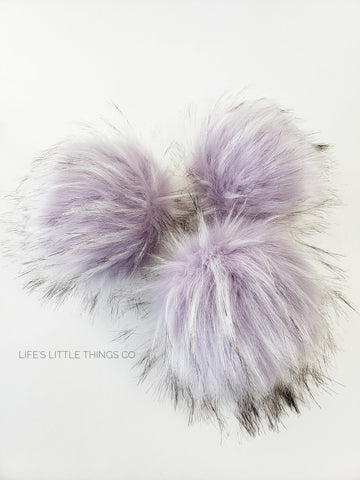 "Wisteria Faux Fur Pom Lavender with tufts of white and black tips Long length fur (approximately 1.5"" - 2.5"") Very full pom Luxurious and amazingly soft feel"