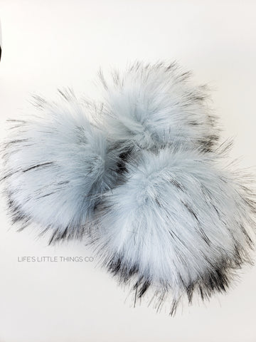 "Reflection Faux Fur Pom Pale blue with tufts of of same color with black tips Long length fur (approximately 2.5"" - 3"") Very full pom Luxurious and amazingly soft feel"