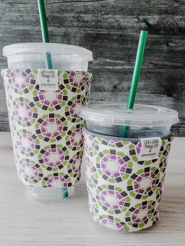 Heptagon & Squares Iced Drink Snug. Tired of sweating iced drink cups?  Or ice just melting too fast in your cold drink?   Insulate your cup with a modern, stylish cup snug.  Keep your coffee cold, hands warm and water rings off the table.  It may also be used on hot cups.