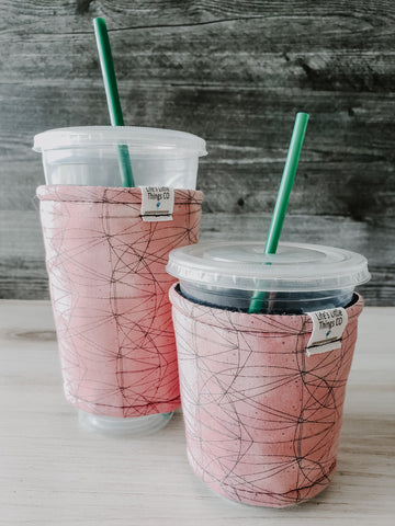 Pink Lines Iced Drink Snug. Tired of sweating iced drink cups?  Or ice just melting too fast in your cold drink?   Insulate your cup with a modern, stylish cup snug.  Keep your coffee cold, hands warm and water rings off the table.  It may also be used on hot cups.