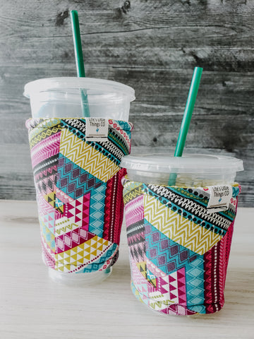 Bright Geometric Iced Drink Snug. Tired of sweating iced drink cups?  Or ice just melting too fast in your cold drink?   Insulate your cup with a modern, stylish cup snug.  Keep your coffee cold, hands warm and water rings off the table.  It may also be used on hot cups.