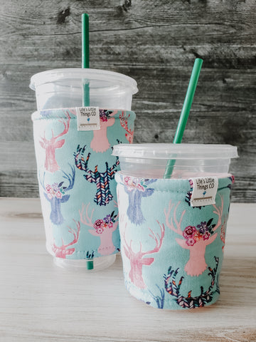 Floral Deer Iced Drink Snug. Tired of sweating iced drink cups?  Or ice just melting too fast in your cold drink?   Insulate your cup with a modern, stylish cup snug.  Keep your coffee cold, hands warm and water rings off the table.  It may also be used on hot cups.