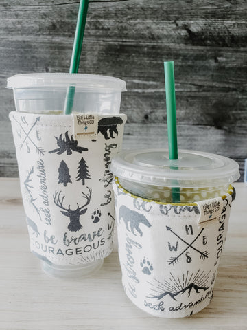 Adventure Iced Drink Snug. Tired of sweating iced drink cups?  Or ice just melting too fast in your cold drink?   Insulate your cup with a modern, stylish cup snug.  Keep your coffee cold, hands warm and water rings off the table.  It may also be used on hot cups.