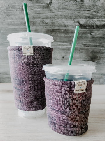 Purple & Black Sketch Iced Drink Snug. Tired of sweating iced drink cups?  Or ice just melting too fast in your cold drink?   Insulate your cup with a modern, stylish cup snug.  Keep your coffee cold, hands warm and water rings off the table.  It may also be used on hot cups.
