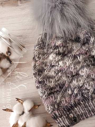 Live. Love. Stay Cozy. Out on the town or on a neighborhood stroll, you will stay warm all fall and winter in this handmade, modern beanie with a medium snap on pom-pom to add a little flair.