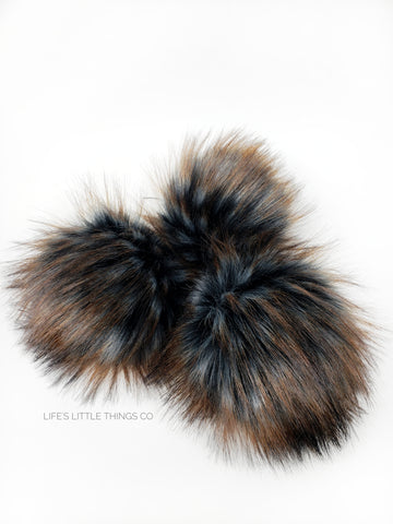 A fun, modern touch to your knitwear.  Make a STATEMENT with a faux fur poof.  Each pom is handmade with high quality faux fur (vegan). Price is for 1 Tricorn Faux Fur Pom Pom