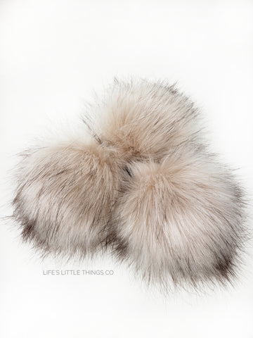 A fun, modern touch to your knitwear.  Make a STATEMENT with a faux fur poof.  Each pom is handmade with high quality faux fur (vegan). Price is for 1 Pearl Faux Fur Pom Pom