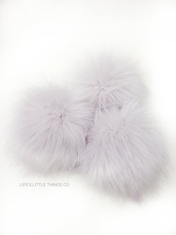 A fun, modern touch to your knitwear.  Make a STATEMENT with a faux fur poof.  Each pom is handmade with high quality faux fur (vegan). Price is for 1 Lilac Faux Fur Pom Pom
