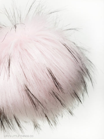 A fun, modern touch to your knitwear.  Make a STATEMENT with a faux fur poof.  Each pom is handmade with high quality faux fur (vegan). Price is for 1 Ballerina Faux Fur Pom Pom