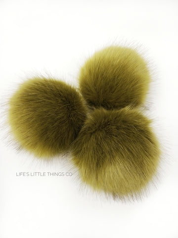 A fun, modern touch to your knitwear.  Make a STATEMENT with a faux fur poof.  Each pom is handmade with high quality faux fur (vegan). Price is for 1 Lemongrass Faux Fur Pom Pom