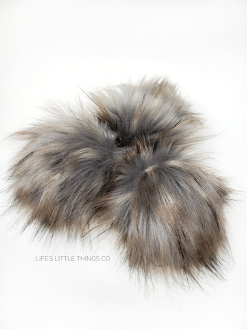 A fun, modern touch to your knitwear.  Make a STATEMENT with a faux fur poof.  Each pom is handmade with high quality faux fur (vegan). Price is for 1 Moonlight Faux Fur Pom Pom