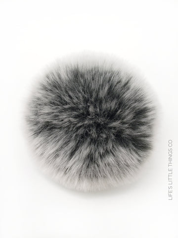 A fun, modern touch to your knitwear.  Make a STATEMENT with a faux fur poof.  Each pom is handmade with high quality faux fur (vegan). Price is for 1 Silver Lining Faux Fur Pom Pom