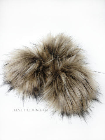 A fun, modern touch to your knitwear.  Make a STATEMENT with a faux fur poof.  Each pom is handmade with high quality faux fur (vegan). Price is for 1 Taupe Faux Fur Pom Pom