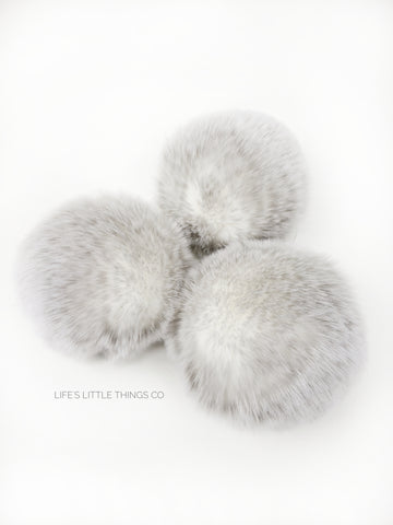 A fun, modern touch to your knitwear.  Make a STATEMENT with a faux fur poof.  Each pom is handmade with high quality faux fur (vegan). Price is for 1 Snow Fox Faux Fur Pom Pom