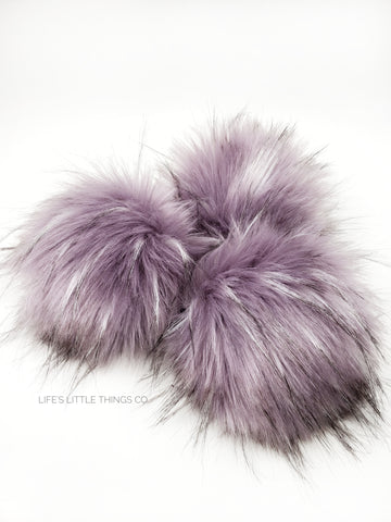 A fun, modern touch to your knitwear.  Make a STATEMENT with a faux fur poof.  Each pom is handmade with high quality faux fur (vegan). Price is for 1 Sugar Plum Faux Fur Pom Pom