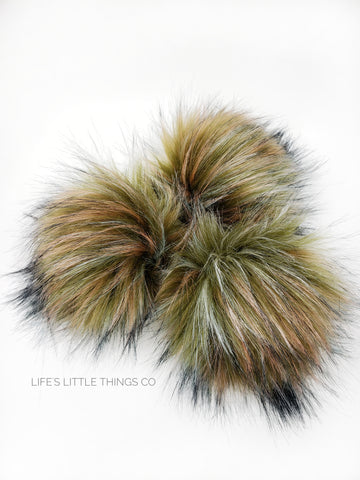 A fun, modern touch to your knitwear.  Make a STATEMENT with a faux fur poof.  Each pom is handmade with high quality faux fur (vegan). Price is for 1 Olive Branch Faux Fur Pom Pom