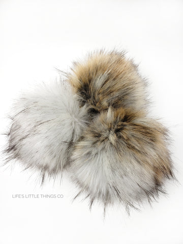 A fun, modern touch to your knitwear.  Make a STATEMENT with a faux fur poof.  Each pom is handmade with high quality faux fur (vegan). Price is for 1 Tawny Faux Fur Pom Pom