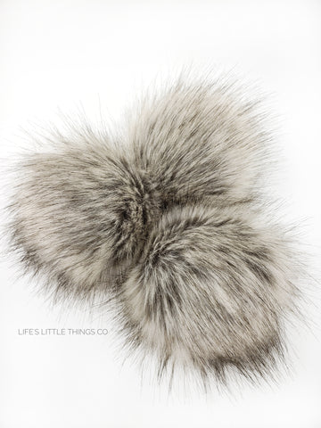 A fun, modern touch to your knitwear.  Make a STATEMENT with a faux fur poof.  Each pom is handmade with high quality faux fur (vegan). Price is for 1 Khaki Faux Fur Pom Pom