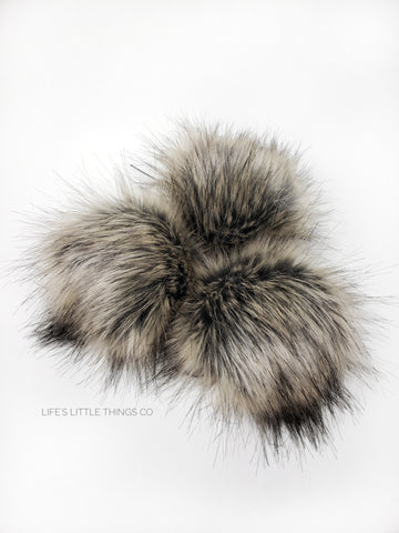 A fun, modern touch to your knitwear.  Make a STATEMENT with a faux fur poof.  Each pom is handmade with high quality faux fur (vegan). Price is for 1 Teddy Faux Fur Pom Pom