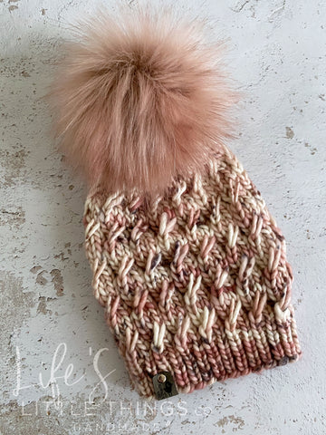 Hand dyed Merino wool in cream, blush and grey.  Topped with a HANDMADE snap on faux fur pom-pom in a dusty blush.