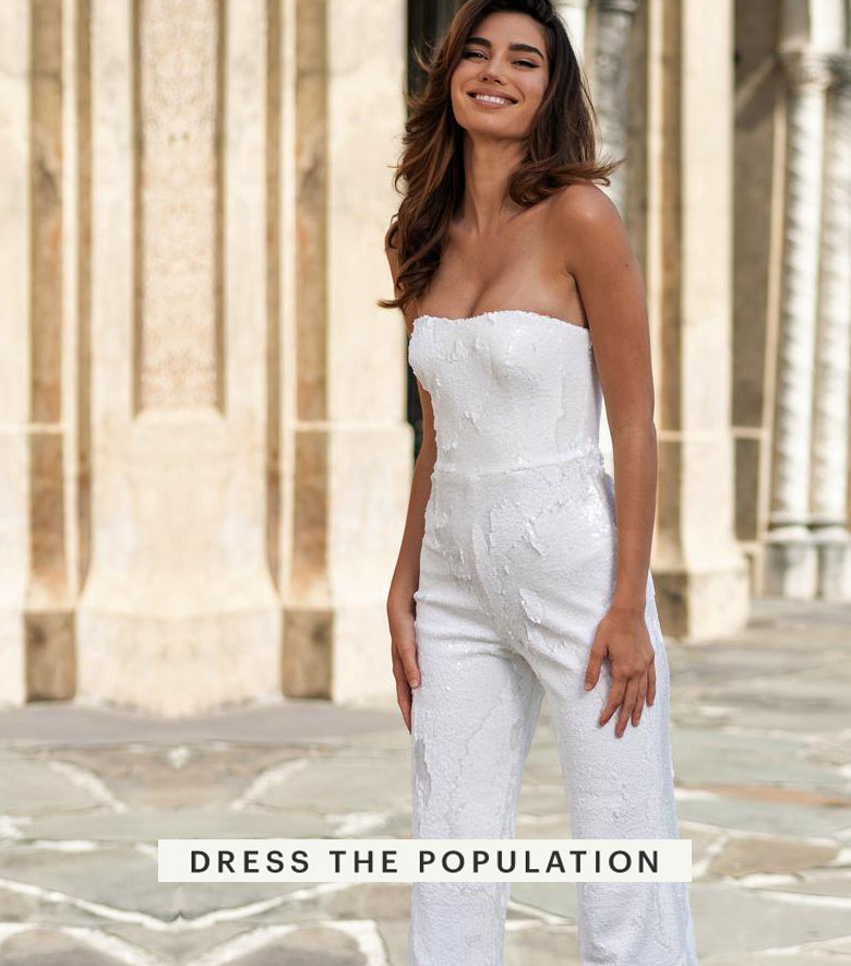 Female model posing in a white jump suit