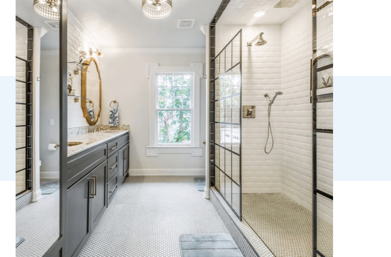 A modern classic bathroom with a walking shower and marble countertops