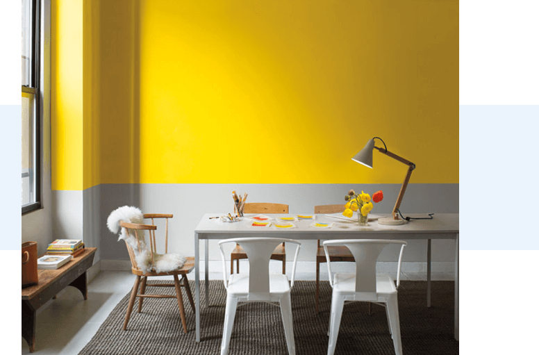 A workplace with yellow walls