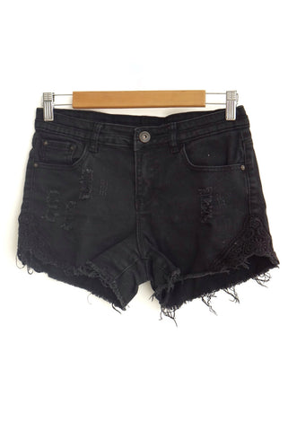 Short negro denim roto