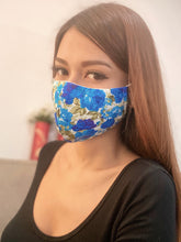 Load image into Gallery viewer, A girl wearing a blue rose printed face mask.