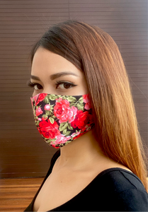 A beautiful girl wearing a red rose printed cotton mask.
