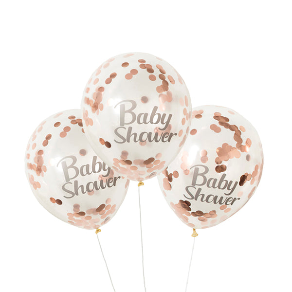 rose gold confetti balloons with baby shower print on white background