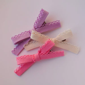 A Trio of Thin Bows with a Laced Edge
