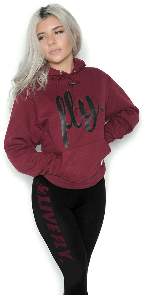 FOREVER LIVE FLY. OUTFIT: MAROON HOODIE/BLACK LEGGINGS