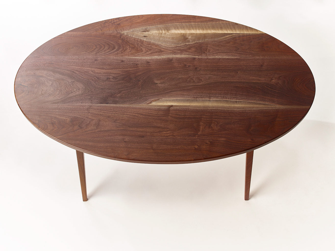 Mid-Century Danish Minimalist Modern Dining Table with Oval or Rectangular Top. Handmade from Solid Wood and Powder Coated / Painted, Chrome, Copper or Brass Plated Steel by Wake the Tree Furniture Co.