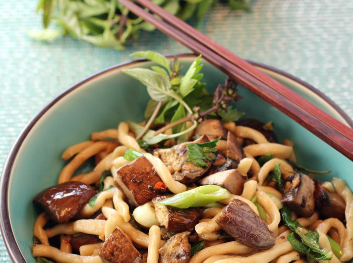 Stir-Fry Udon Noodles with Eggplant, Portobello Mushrooms, Thai Basil, and Celery Leaves