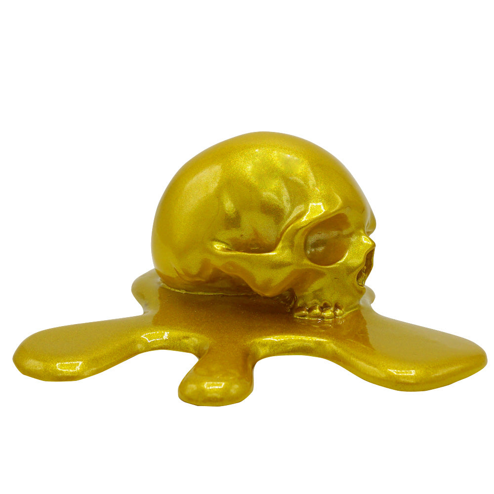 'MELTING IN THE SUN' - MELTED RESIN SKULL - GOLD
