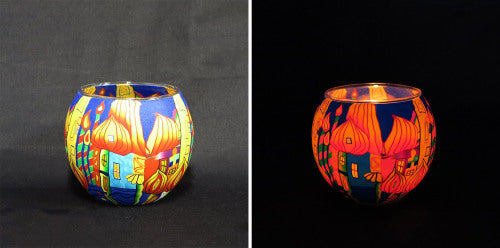 Transport yourself to India with this colourful, glass tealight candle holder