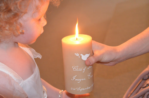 christening or naming day candle hand painted on a pure beeswax pillar candle