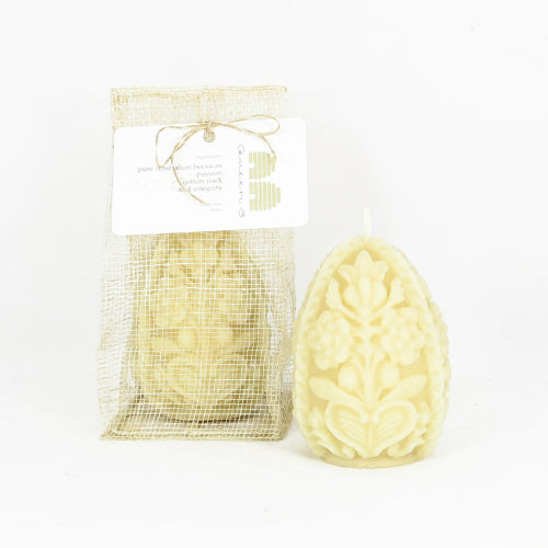 Carved egg beeswax candle in biodegradable sinamay bag packaging