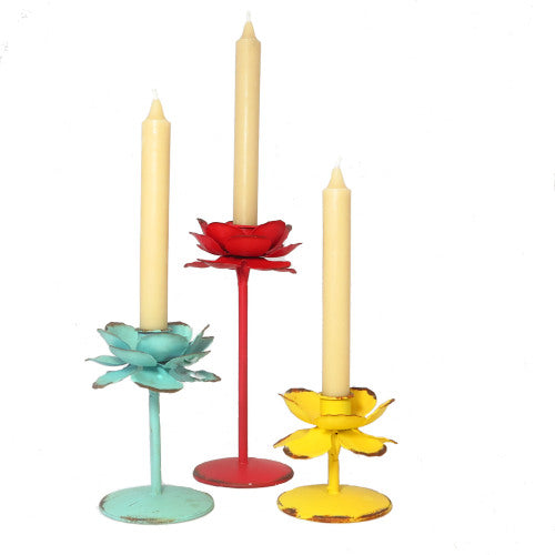 Beeswax dinner candles in metal industrial flower candleholders
